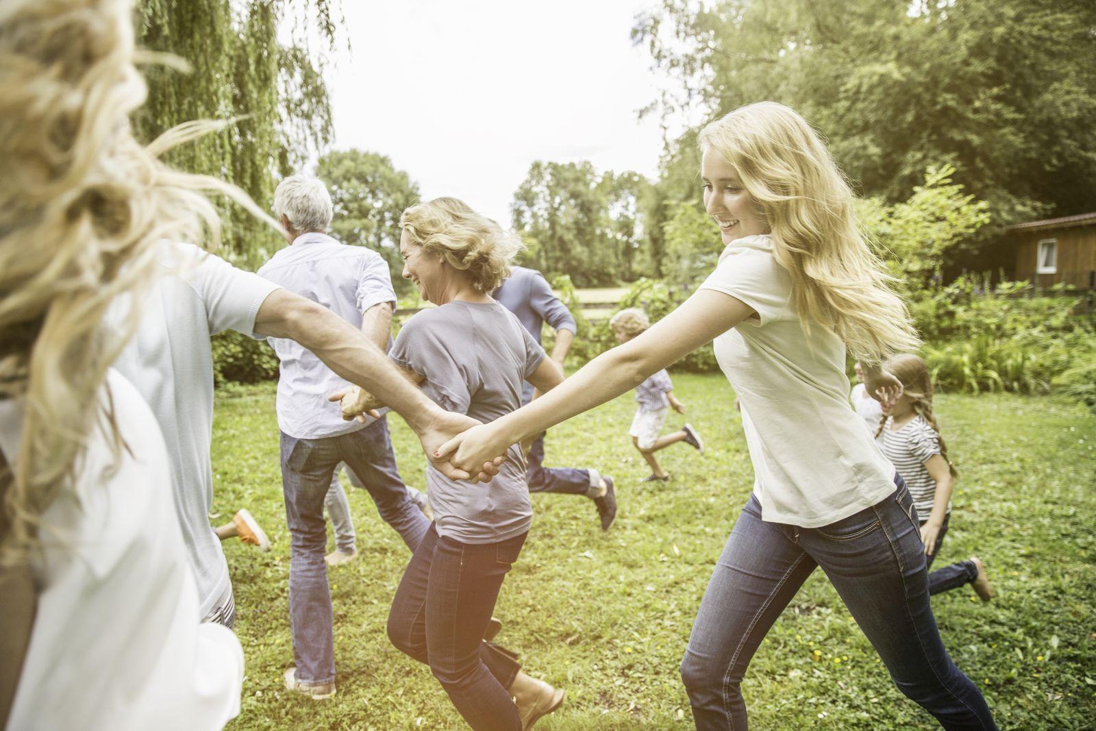 Family running in garden