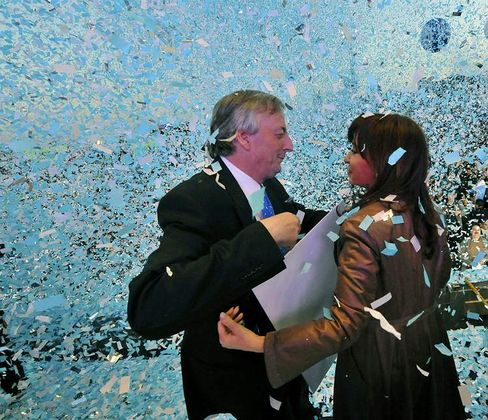 Argentinian President Cristina Kirchner hugs her husband Nestor, who is running for Congress, at a campaign rally in Buenos Aires.