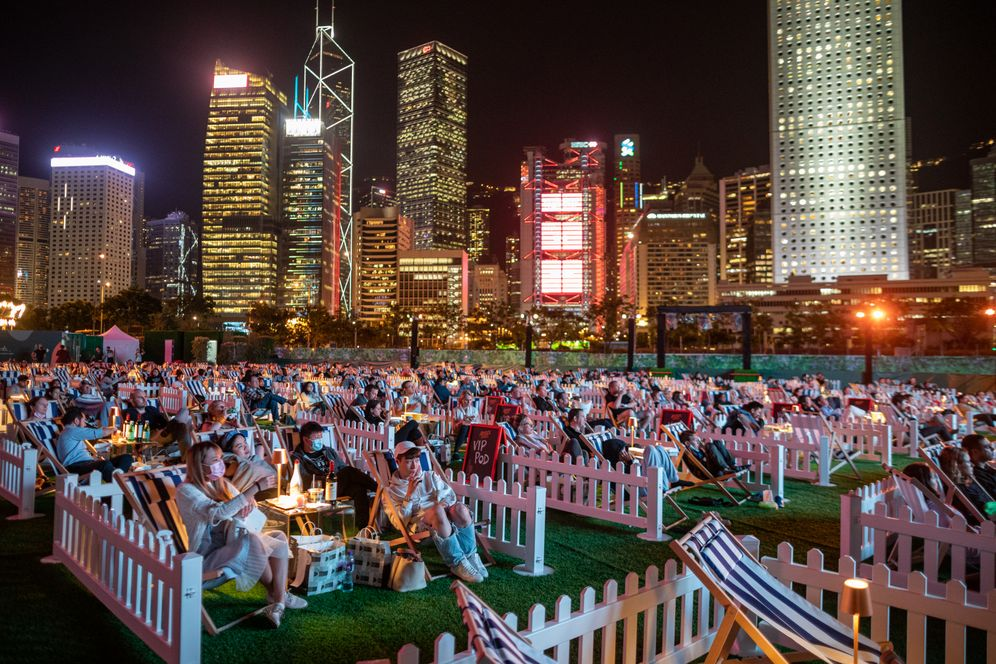 Cinema-goers watch a film at the harbor in Hong Kong's Central district.