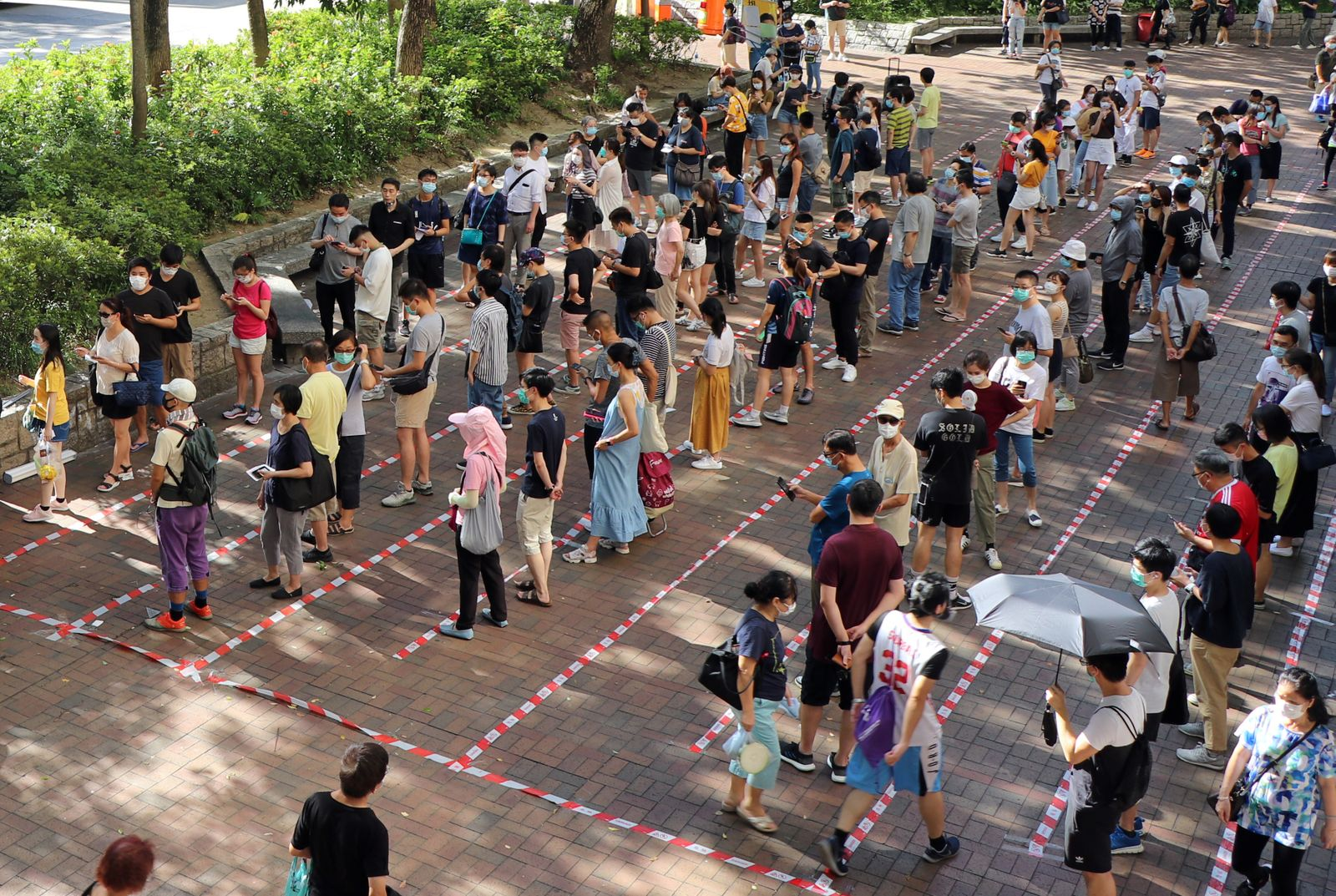 Voters queue up to vote during primary elections aimed for selecting democracy candidates, in Hong Kong