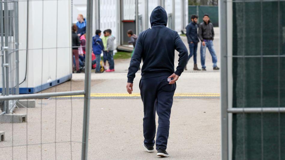 Menschen in einer Flüchtlingsunterkunft in Hamburg