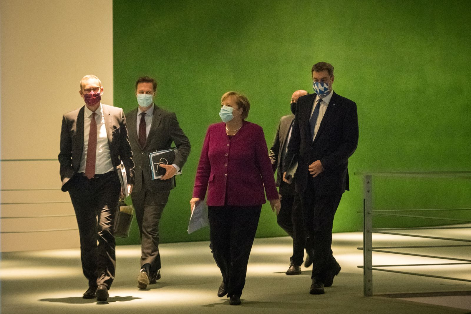 German Chancellor Angela Merkel , Bavaria's State Premier Markus Soeder and Berlin's mayor Michael Mueller arrive to give a press conference after a meeting of states' leaders on the coronavirus situation in Berlin