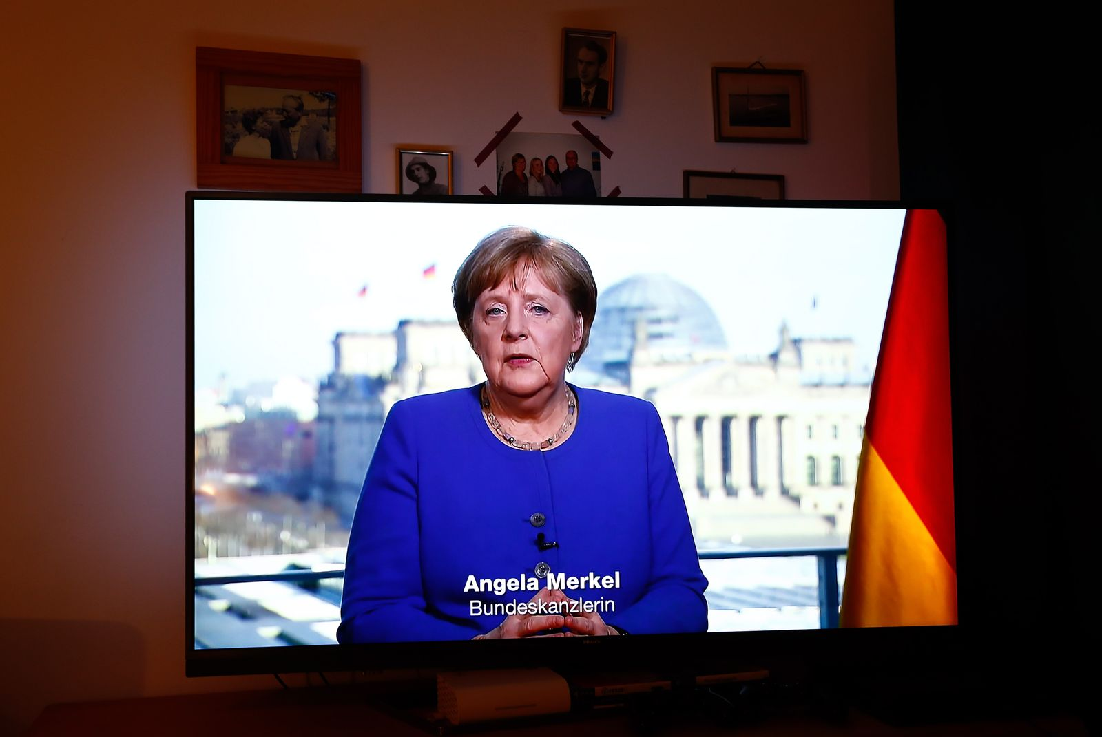 Family Bruhn watches German Chancellor Angela Merkel on television in Berlin
