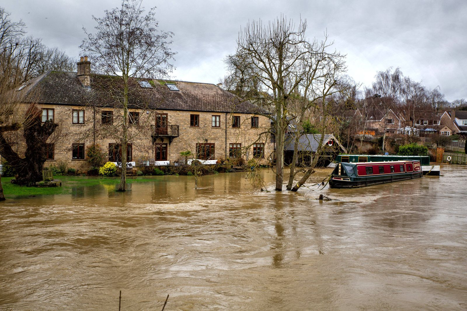 December 26, 2020, Thrapston, United Kingdom: Canal boat moored as fields flood with water..The River Nene at Thrapston