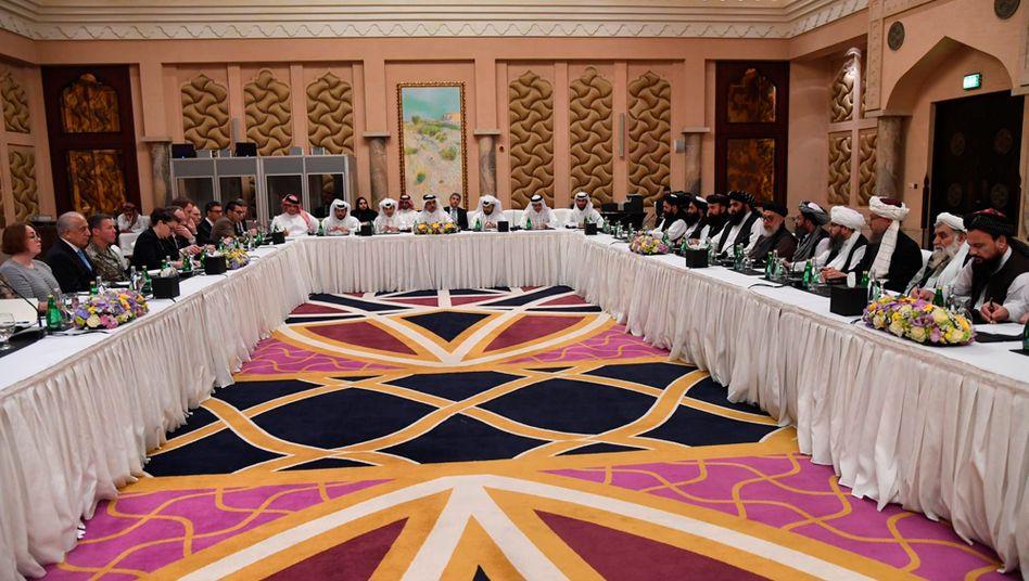 Verhandlungen des Sonderbeauftragten der US-Regierung Khalilzad mit Vertretern der Taliban in Doha 2019