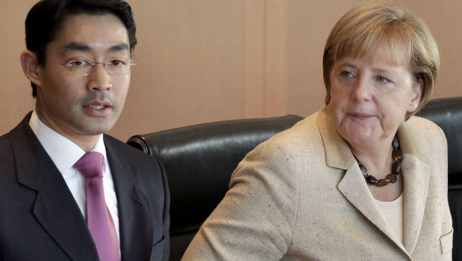 Merkel and Economy Rösler before the weekly cabinet meeting in Berlin on Wednesday.