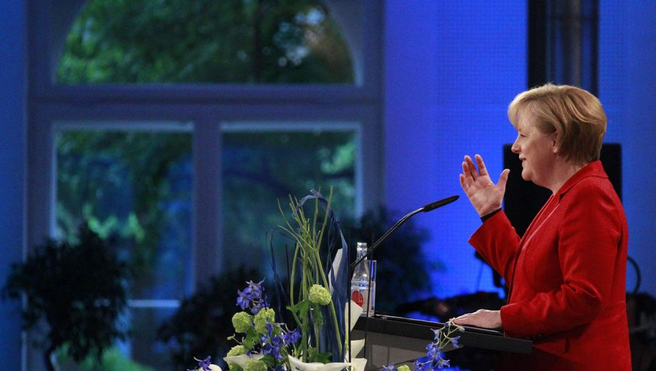 German Chancellor Angela Merkel is trying to convince German voters that bailing out Greece was the right thing to do.