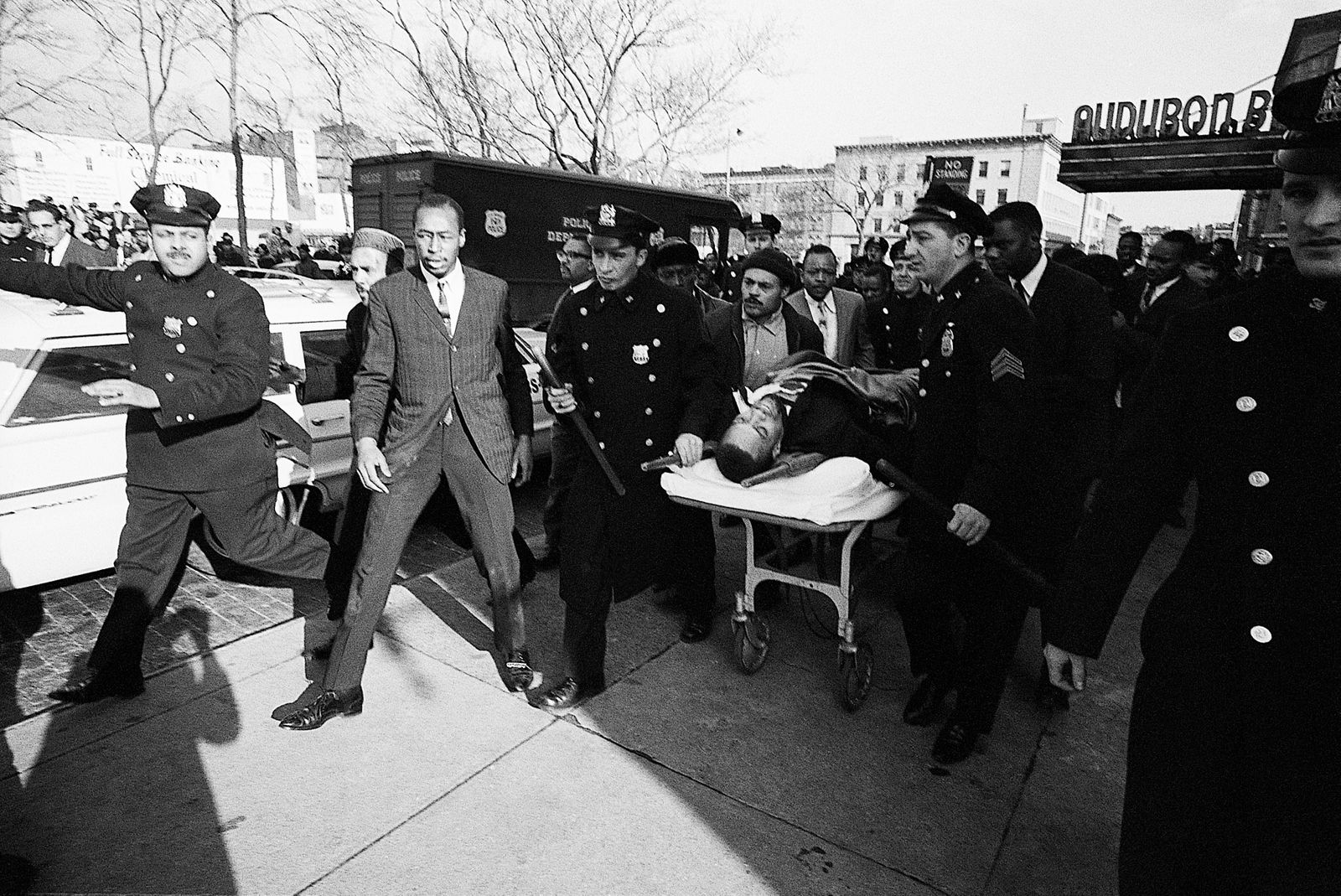 Police Carry Stretcher with Malcolm X's Body