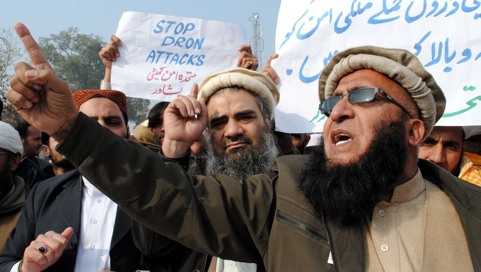 A Jan. 5 demonstration in Peshawar against US drone attacks: A group of victims' relatives is suing the US government and the CIA.