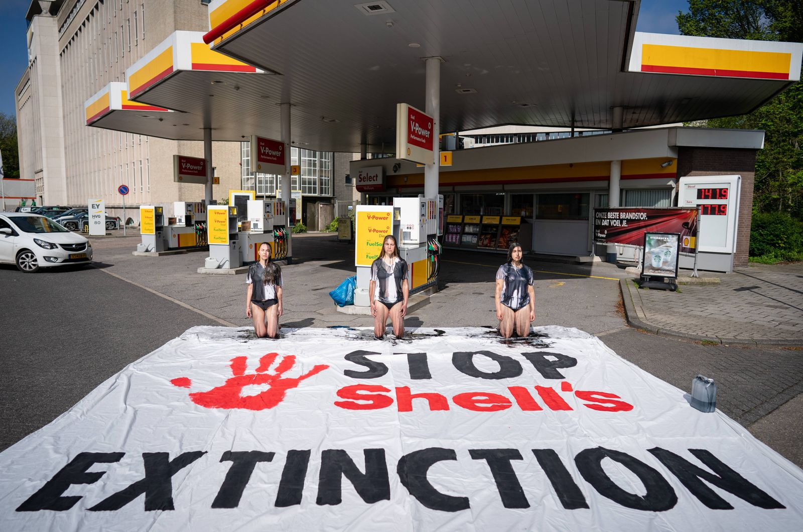 THE HAGUE - Campaigners demonstrate at a Shell gas station during a Shell must fall promotion by Extinction Rebellion a