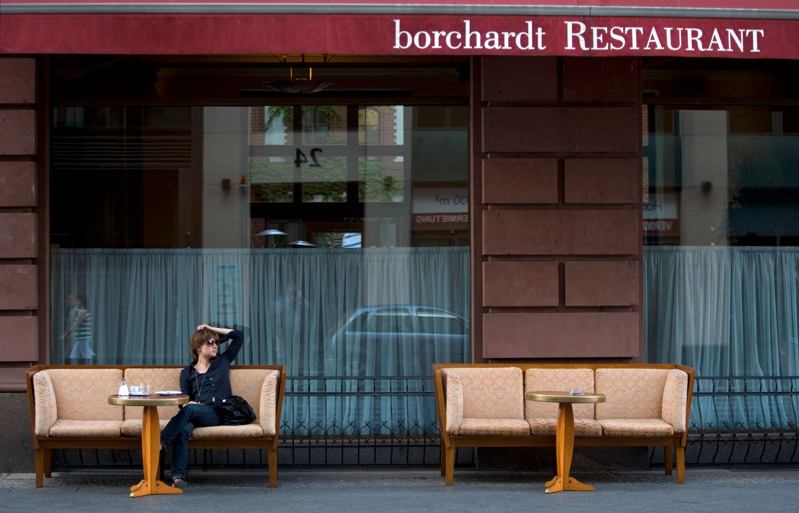 A woman sits outside the Borchardt restaurant in Berlin