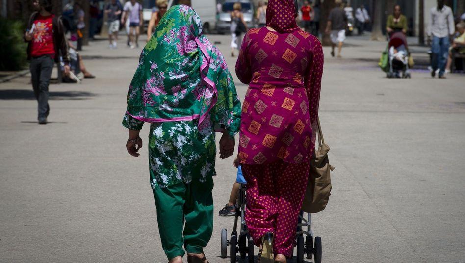 Frauen in Vollverschleierung: Die Bevölkerung begrüßt das Verbot