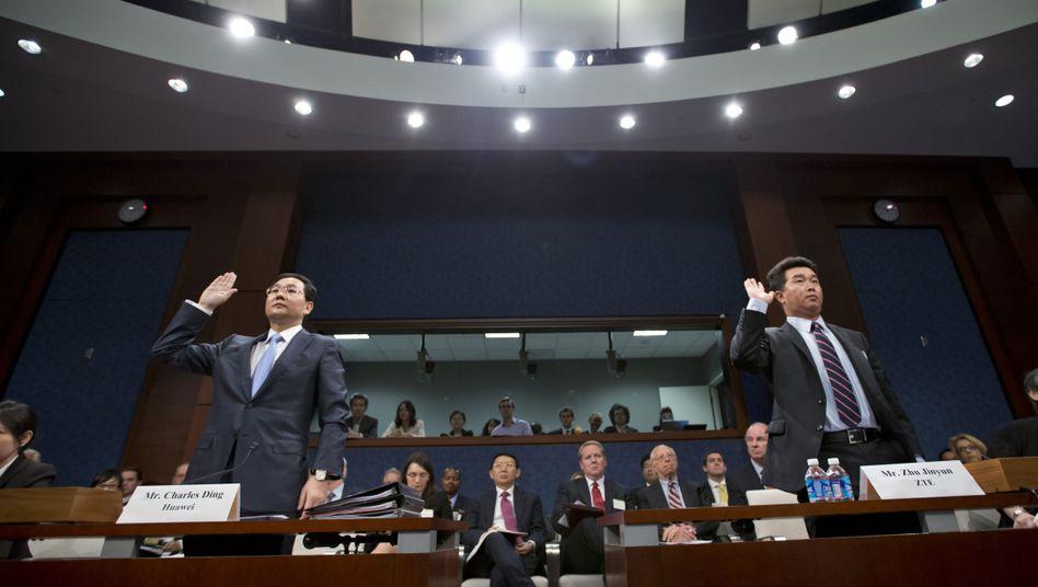 In der Defensive: Manager von Huawei und ZTE vor dem Untersuchungsausschuss