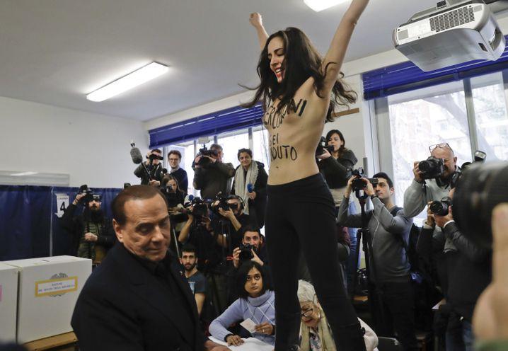 Berlusconi und Aktivistin in Mailand