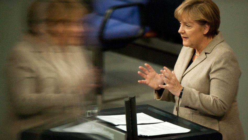 German Chancellor Angela Merkel speaks before parliament on Wednesday: