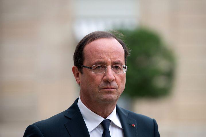 Präsident François Hollande: Mit Plänen seines Vorgängers Sarkozy konfrontiert