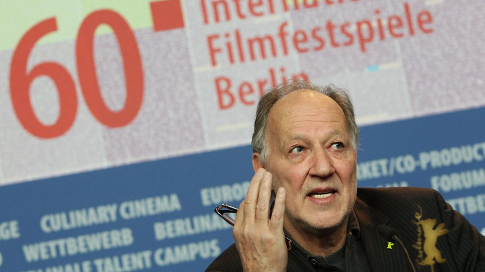 Werner Herzog addresses reporters on the opening day of the 60th Berlin International Film Festival.