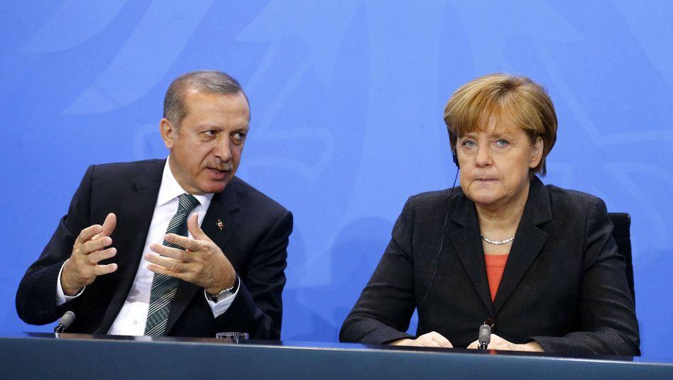 Der türkische Staatschef Erdogan und Kanzlerin Merkel