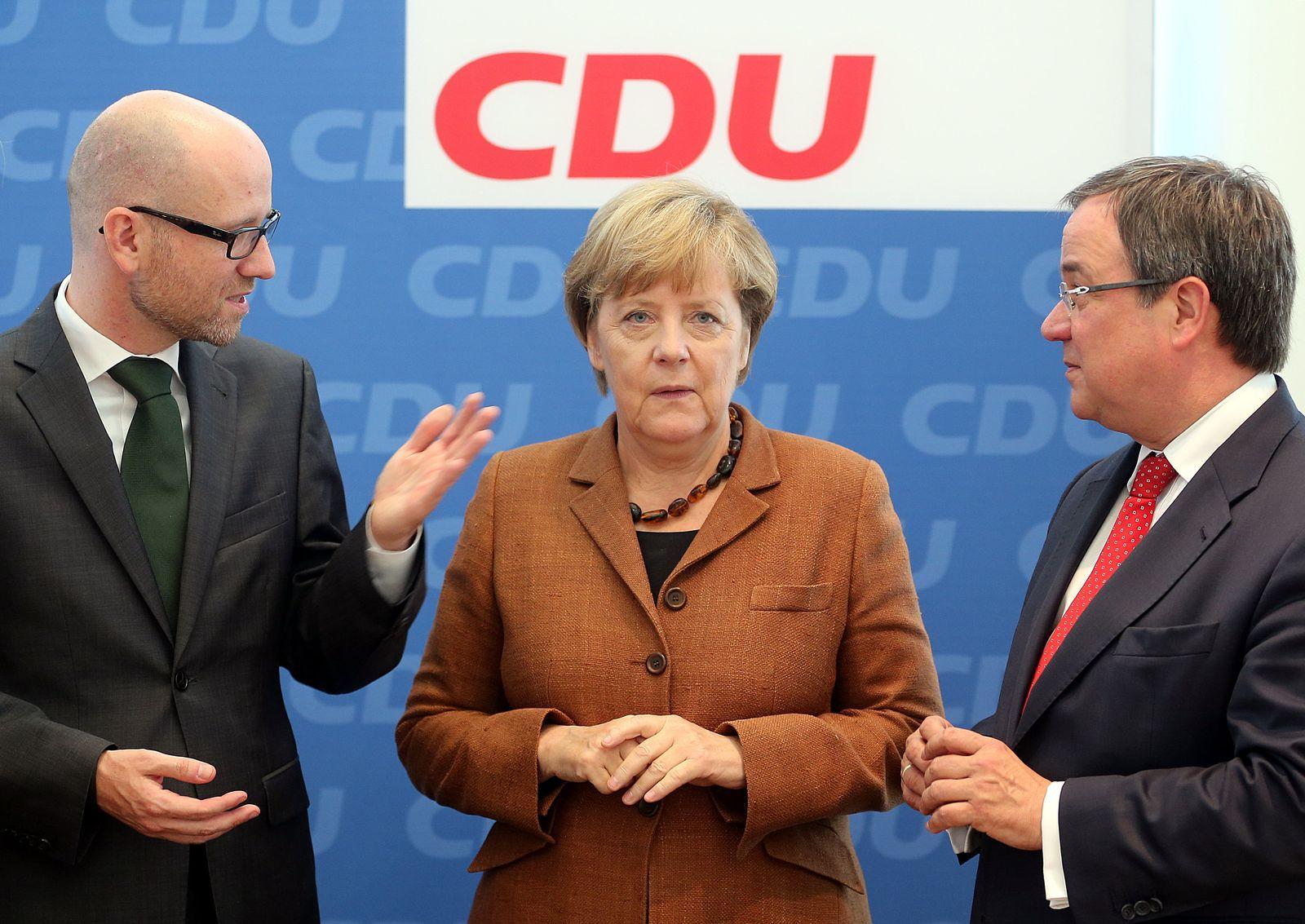 Tauber / Merkel / Laschet