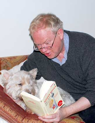 Dog-eared: Boyes loves nothing better than to read his new tome to his pooch.