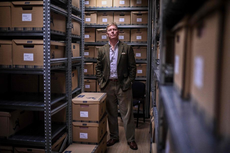Bill Wiley, who hunts down war criminals, in the file storage room of CIJA, the organization he founded.