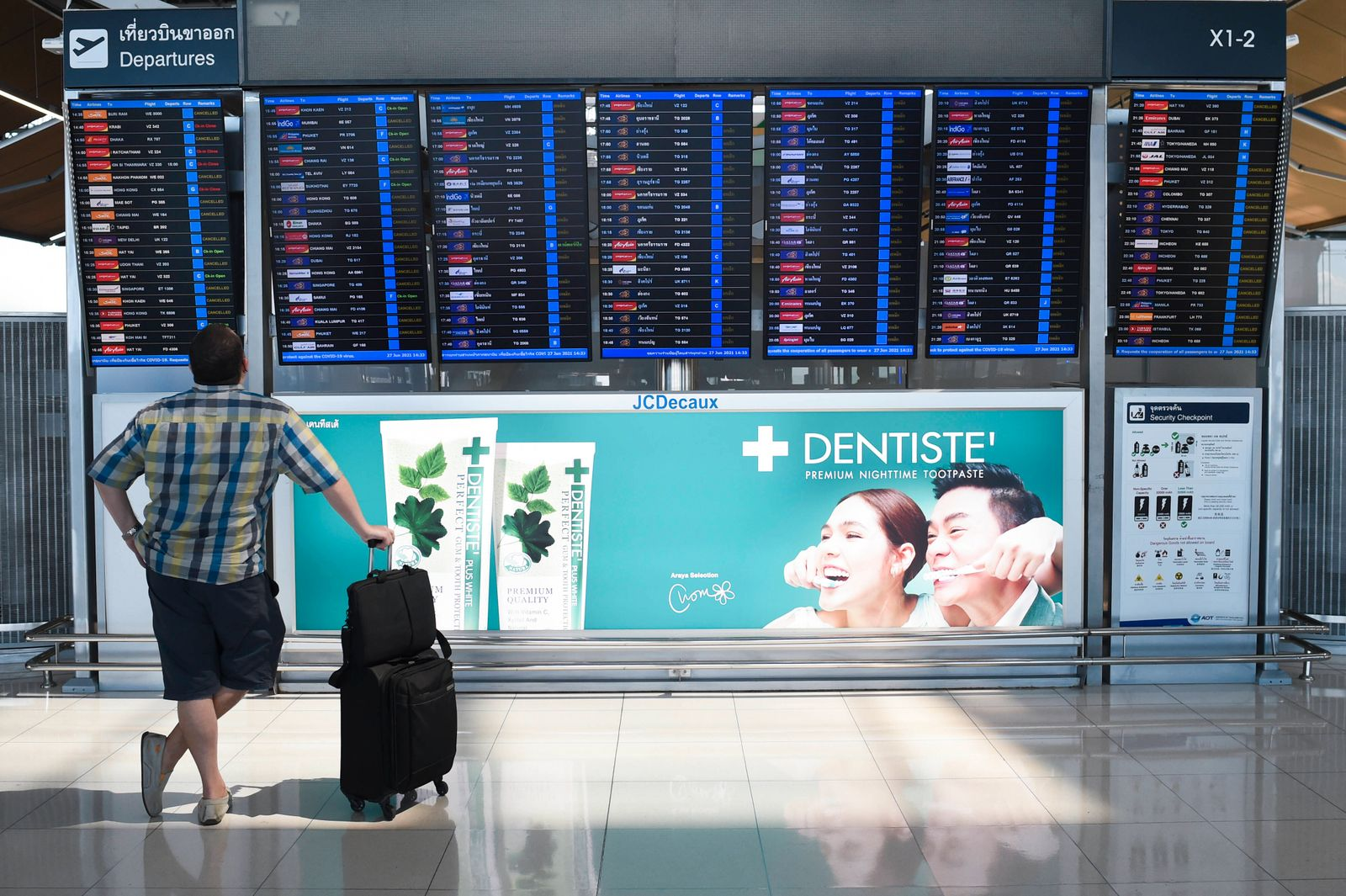 Thailand Plans To Reopen To Vaccinated Foreign Tourists Travelers check for their flight s check-in details at the Suva