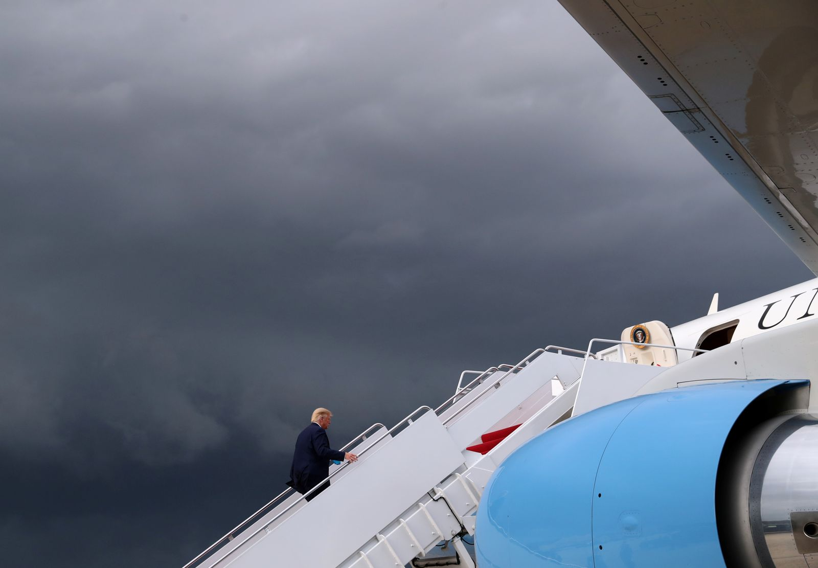 U.S. President Donald Trump boards Air Force One as he departs Washington on campaign travel to Latrobe, Pennsylvania, at Joint Base Andrews in Maryland