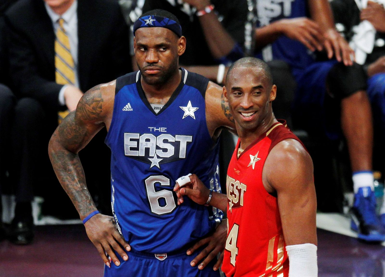 FILE PHOTO: West All Star Bryant of the Lakers stands with East All Star James of the Heat near the end of the NBA All-Star basketball game in Los Angeles