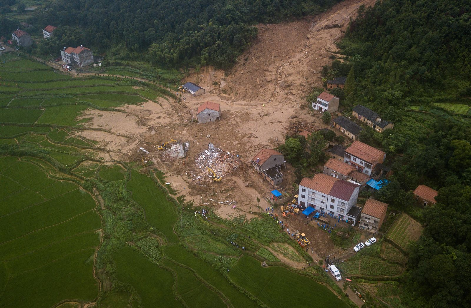 (200709) -- HUANGMEI, July 9, 2020 -- Aerial photos shows the rescue site of a landslide at Yuanshan Village, Dahe Towns