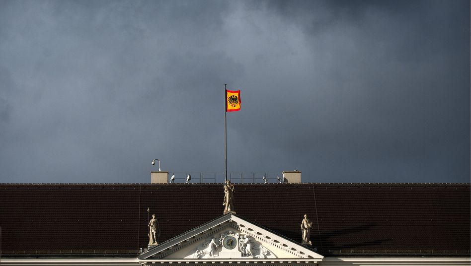 The presidential standard flies above Wulff's official residence in Berlin, Bellevue Palace.