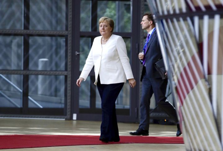 Angela Merkel as she arrived at a meeting of EU leaders on Sunday. The German chancellor has had to shift course multiple times on nominations for important posts in Brussels.