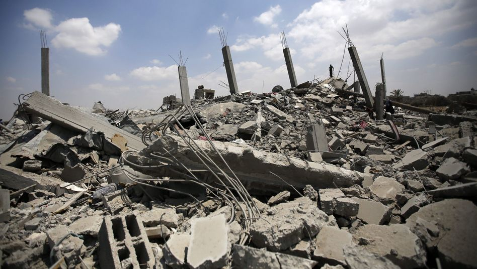 """Rubble of destroyed houses in the southern Gaza Strip after the Israeli withdrawal on Tuesday: """"I think Israelis have lost what we can call a 'humanitarian sensibility,' the capacity to identify with the suffering of a distant other."""""""