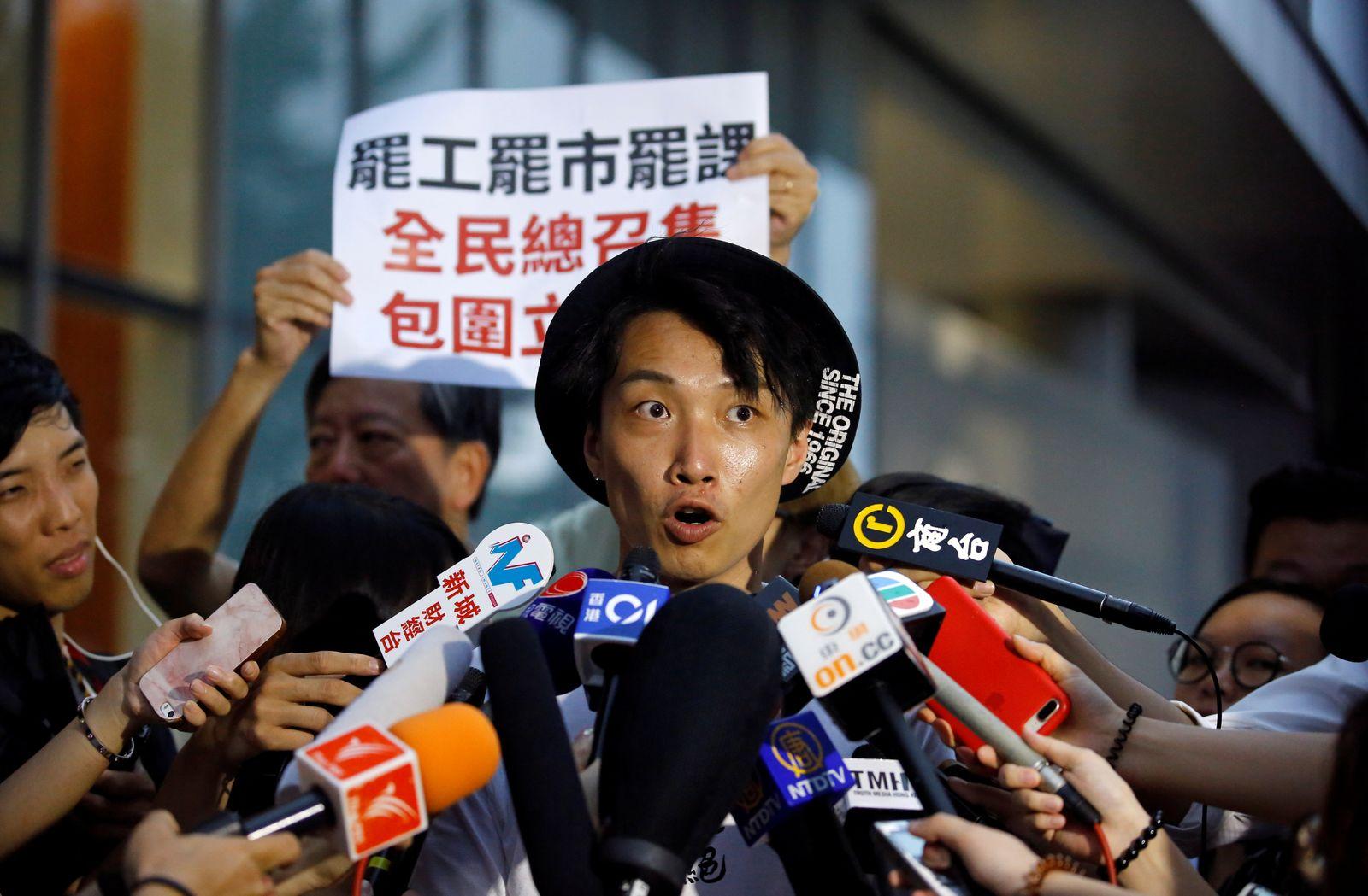 Protest organiser Jimmy Sham addresses the media outside the Legislative Council building in Hong Kong