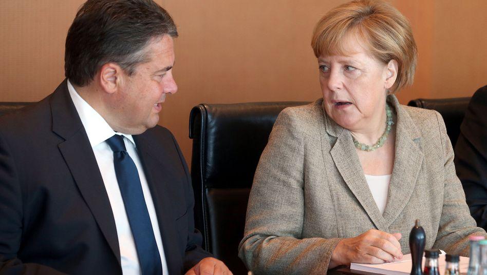 """Vizekanzler Gabriel, Regierungschefin Merkel: """"Wir können nicht zusehen, wie bis an die Zähne bewaffnete Fanatiker Tausende unschuldige Menschen umbringen"""""""