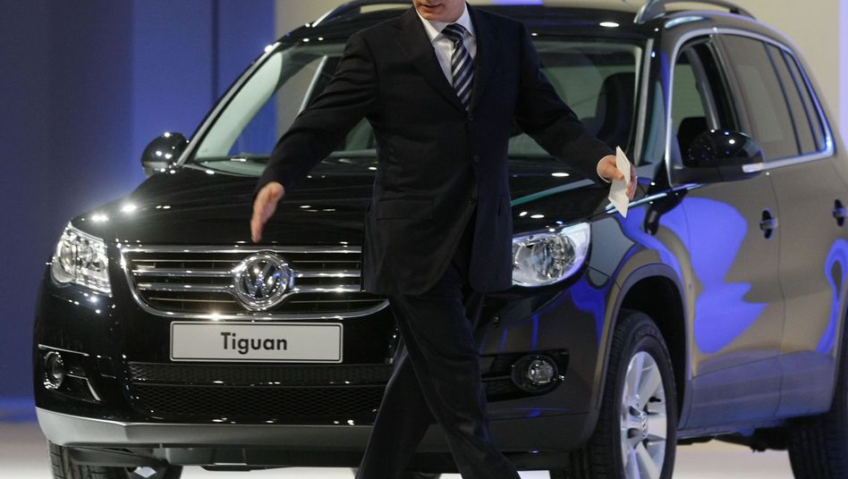 Russian Prime Minister Vladimir Putin walks in front of Volkswagen Tiguan at the opening ceremony of the VW assembly plant in Kaluga, Russia.