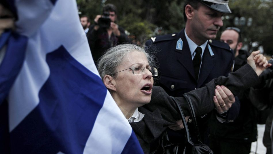 Police detain a woman at a weekend demonstration in Athens.