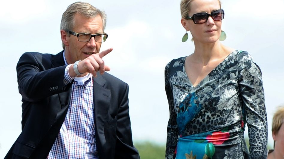 Former German President Christian Wulff and his wife Bettina pictured in July.