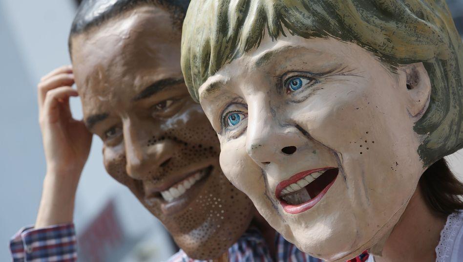 Demonstranten mit Obama- und Merkel-Maske: Welche Bilder bleiben vom Gipfel in Erinnerung?