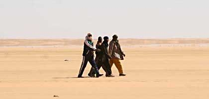 Making their Way to Europe: Migrants wander across the Sahara in Assamaka, a border outpost between Niger and Algeria.