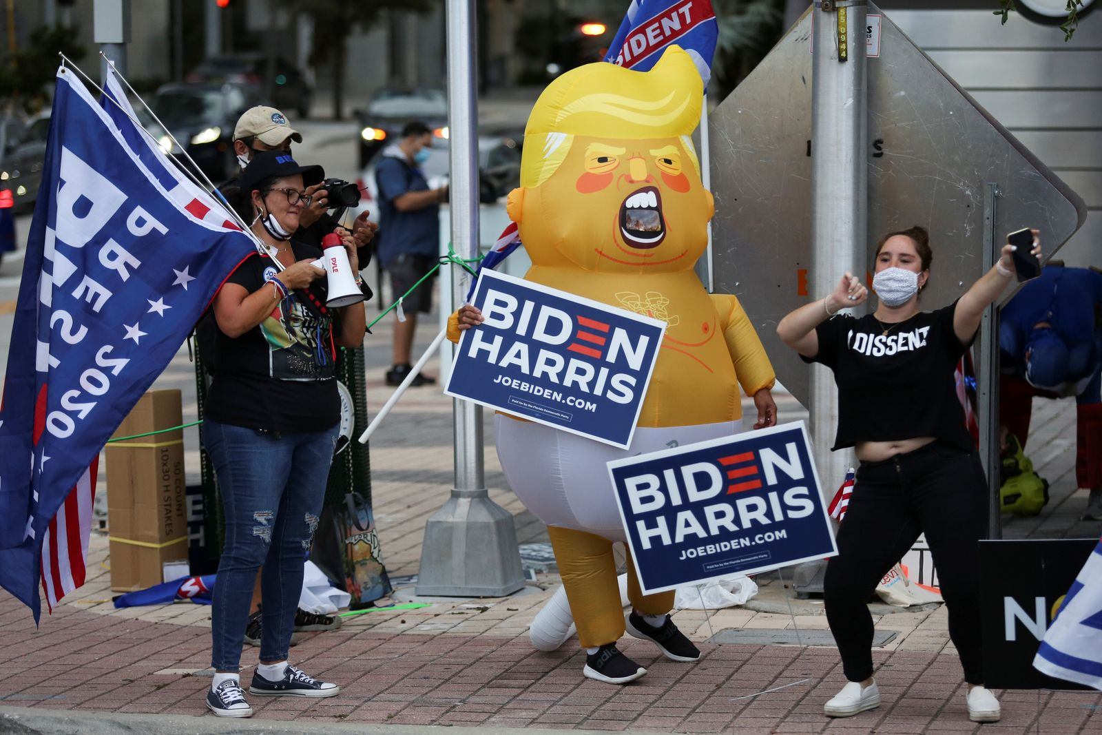 Supporters of Democratic U.S. presidential nominee Joe Biden gather outside Perez Art Museum before the arrival of U.S. President Donald Trump for a town hall in Miami