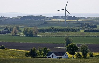 A windmill rises over farmland on the Danish island of Samso.