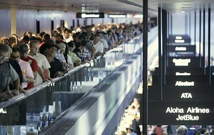 Crowds of people wait in line to go through security at McCarran International Airport in Las Vegas. The US wants European flight data to prevent terrorism.