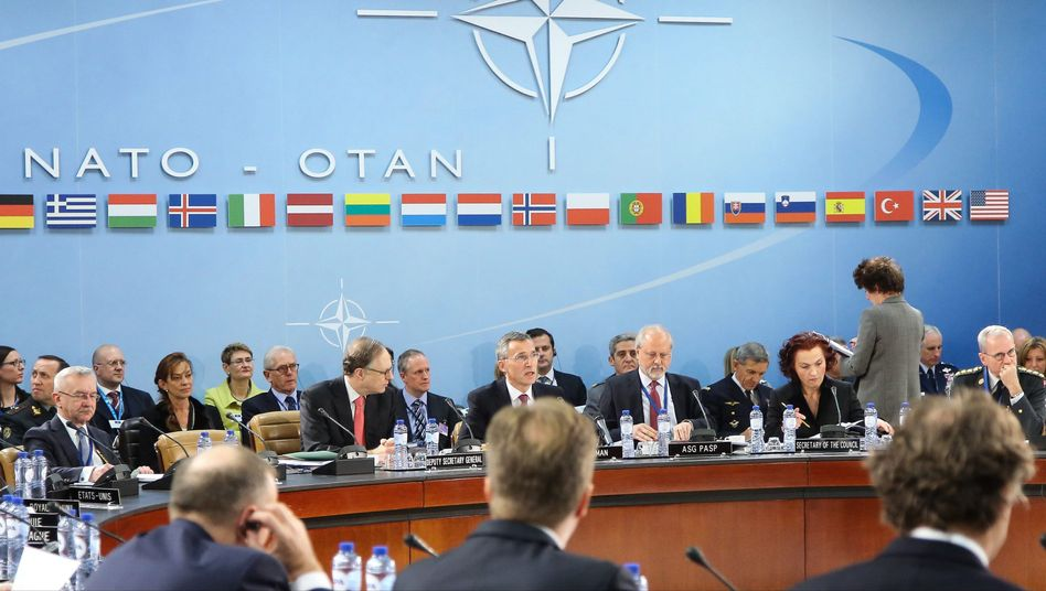 NATO Secretary General Jens Stoltenberg (third from left) speaks at the start of a meeting of NATO ministers of foreign affairs on Tuesday.