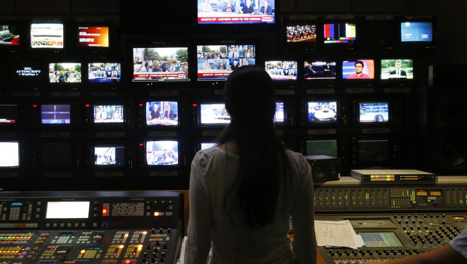 An employee of state broadcaster ERT in the station's control room in Athens.