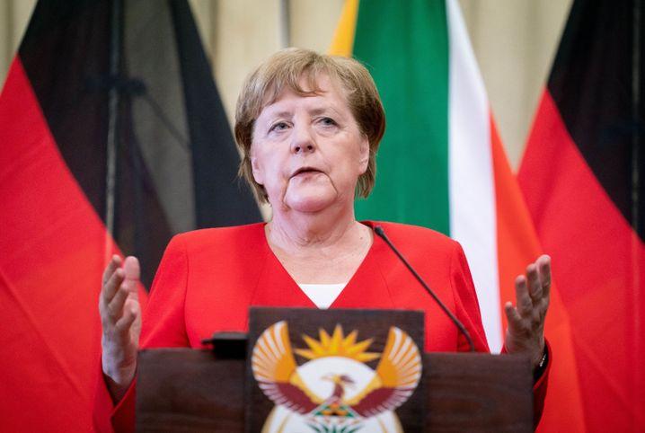 Angela Merkel auf der Pressekonferenz in Südafrika, wo sie sich zur Thüringer Regierungsbildung äußerte