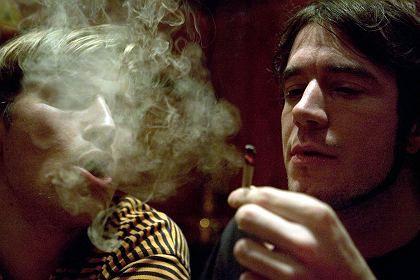 A man enjoying cannabis legally in a Dutch bar.