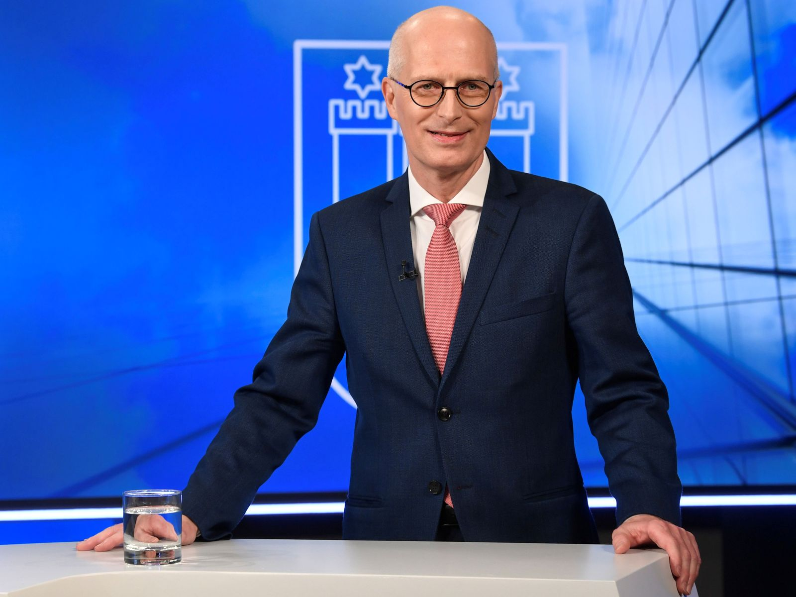 FILE PHOTO: Top candidate and mayor of Hamburg Peter Tschentscher of the Social Democrats (SPD) poses for the media before a TV debate with his challenger Katharina Fegebank of the Greens in Hamburg