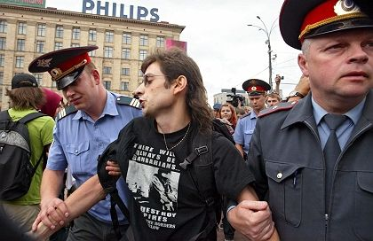 Police in Moscow arrest an environmental activist attending a protest in opposition of the Sochi bid.