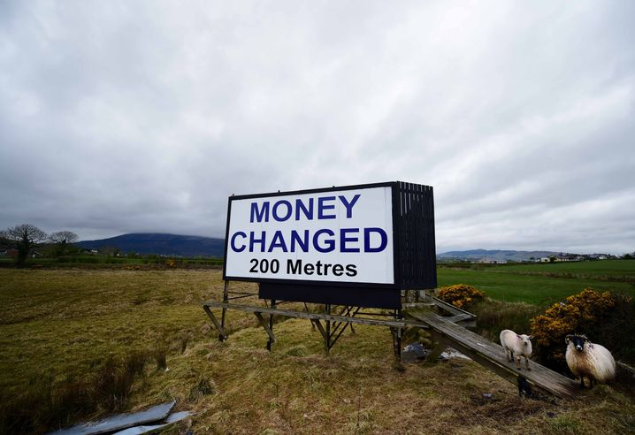 A billboard advertising pounds sterling to euros money changing services on May 1, 2016 in Newry, Northern Ireland.