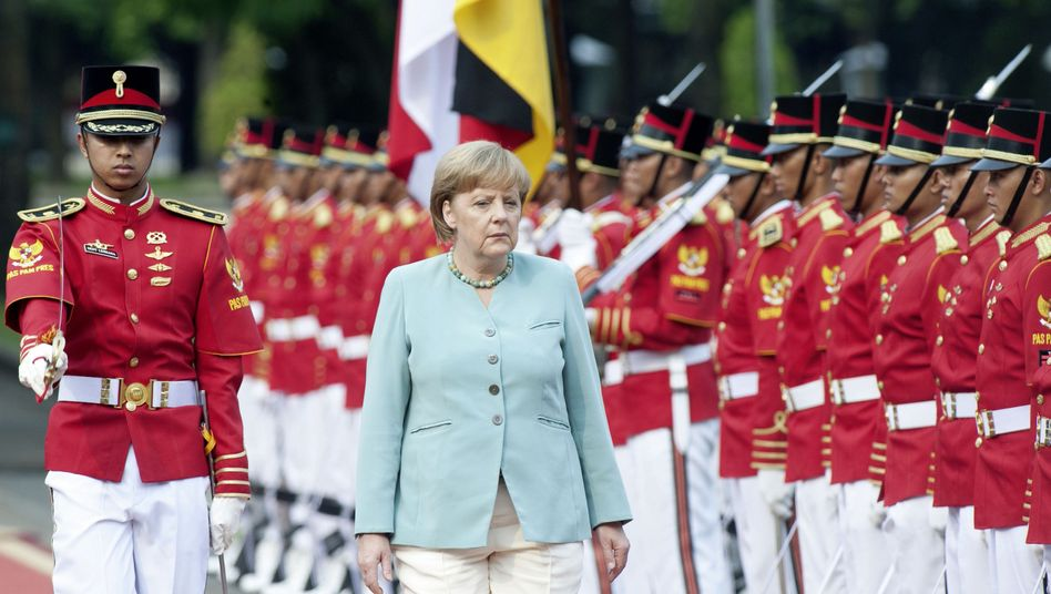 Merkel on a visit to Jakarta, Indonesia this July. The country wants German weapons.